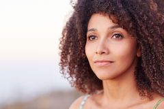 Closeup of a beautiful woman looking into the distance Royalty Free Stock Photo