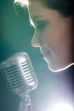 Closeup of beautiful woman with microphone Stock Photography