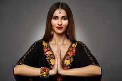 Beautiful woman in oriental outfit Stock Photo