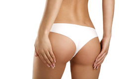 Closeup of a beautiful woman showing perfect buttocks Stock Photos