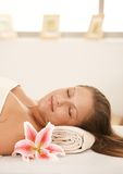 Closeup of beautiful woman sleeping on massage bed Stock Photography