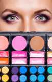 Closeup of beautiful womanish eyes with makeup kit Royalty Free Stock Photos