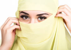 Closeup of beautiful young arabian woman in yellow hijab. Charm and beauty of the East. Stock Photography