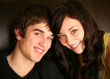 Closeup of beautiful young couple smiling stock photo