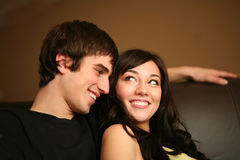 Closeup of beautiful young couple smiling royalty free stock photography