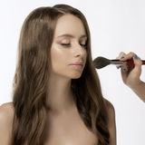 Closeup Of Beautiful Young Female Model Putting Blush With Cosme Stock Photo