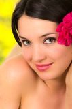 Closeup of beautiful young girl with flower on her Stock Images