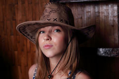 Closeup of beautiful young girl with long blond hair In hat Royalty Free Stock Images