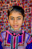 Closeup of beautiful young girl with traditional embroydered cos Royalty Free Stock Photography