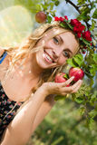 Closeup on beautiful young lady apple fairy with three fruits Royalty Free Stock Image