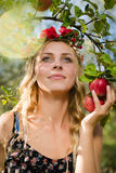 Closeup on beautiful young lady apple fairy with three fruits Stock Images