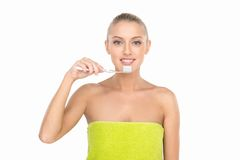 Closeup of beautiful young lady holding toothbrush and smiling. Stock Photography