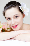 Closeup of beautiful young woman face with flower Royalty Free Stock Photos