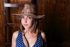 Closeup of beautiful young smiling girl in hat Stock Photography