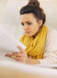 Attractive Young Woman Busy Reading a Book Royalty Free Stock Photo