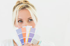 Closeup of a beautiful young woman holding color swatches Stock Image