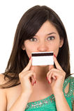 Closeup beautiful young woman holding credit card Stock Photo