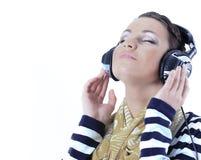 Closeup.beautiful young woman listening to music Stock Photos