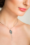 Closeup of beautiful young woman with necklace Royalty Free Stock Image