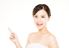 Closeup beautiful young   woman  with pointing gesture Royalty Free Stock Image