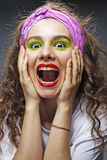 Closeup of beautiful young woman screaming Stock Photography