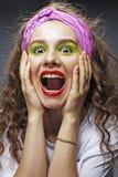 Closeup of beautiful young woman screaming Stock Photography