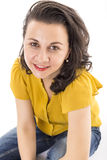 Closeup of a beautiful young woman sitting on floor and looking Royalty Free Stock Photography