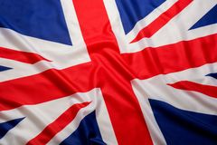 Closeup beautifully wavingof UK British flag Union Jack flag background.  stock photo