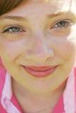 Closeup beauty. Closeup of teenage girl in pink shirt Royalty Free Stock Photo