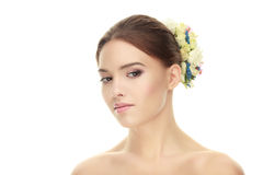 Closeup beauty portrait of adorable calm brunette woman with flower headpiece showing cute fresh makeup posing with bare shoulders Royalty Free Stock Image