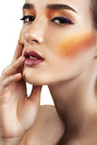 Closeup beauty portrait of attractive model face with bright mak. E-up. Perfect clean skin Stock Photos