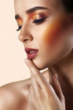 Closeup beauty portrait of attractive model face with bright mak. E-up. Perfect clean skin Royalty Free Stock Images
