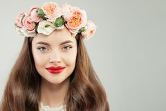 Closeup Beauty Portrait of Beautiful Model with Healthy Hair, Makeup and Flowers Wreath. Spring Beauty Woman Face.  royalty free stock images