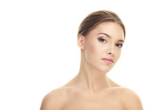 Closeup beauty portrait of calm young adorable brunette woman with trendy makeup posing with bare shoulders on white studio backgr Stock Images