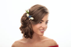 Closeup beauty portrait of smiling young adorable brunette woman with trendy makeup low bun hairstyle flower headpiece on white ba Royalty Free Stock Images