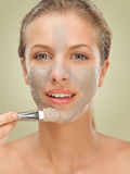 Closeup beauty portrait woman applying facial mask stock images