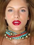 Closeup beauty portrait woman with colorful jewels Royalty Free Stock Images