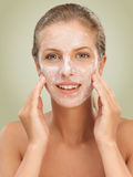 Closeup beauty portrait woman with facial mask Stock Photos