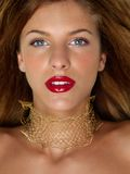 Closeup beauty portrait woman with golden jewels Royalty Free Stock Photography