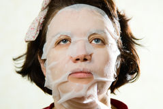 Closeup beauty portrait of woman with a mask on her face for tre Stock Images