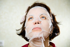 Closeup beauty portrait of woman with a mask on her face for tre Royalty Free Stock Photo
