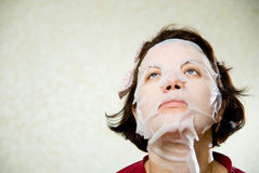 Closeup beauty portrait of woman with a mask on her face for tre Royalty Free Stock Image