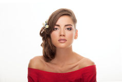 Closeup beauty portrait of young adorable brunette woman in red shirt with bare shoulders showing low bun hairstyle and trendy nat Royalty Free Stock Photo