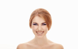 Closeup beauty portrait of a young beautiful laughing woman with violet eyes makeup on  isolated background Royalty Free Stock Images