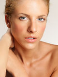 Closeup beauty portrait of young, blonde woman Stock Photography