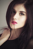 Closeup beauty portrait of young brunette girl. Red lips Royalty Free Stock Photos