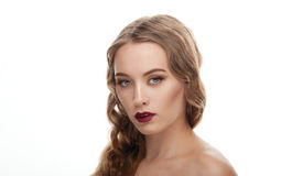 Closeup beauty portrait of young elegant model with bare shoulders and trendy fashion makeup Stock Images