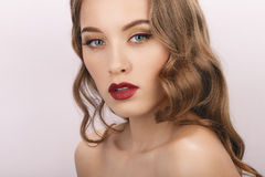 Closeup beauty portrait of young fashionable model with bare shoulders curly hairstyle and trendy gorgeous makeup. Closeup beauty portrait of young fashionable Stock Image