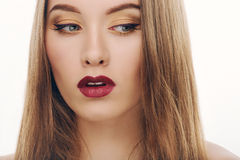Closeup beauty portrait of young fashionable model with trendy gorgeous eyes makeup. Closeup beauty portrait of young fashionable girl with trendy gorgeous eyes Royalty Free Stock Photos