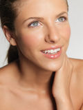 Closeup beauty portrait of young woman smiling Royalty Free Stock Images